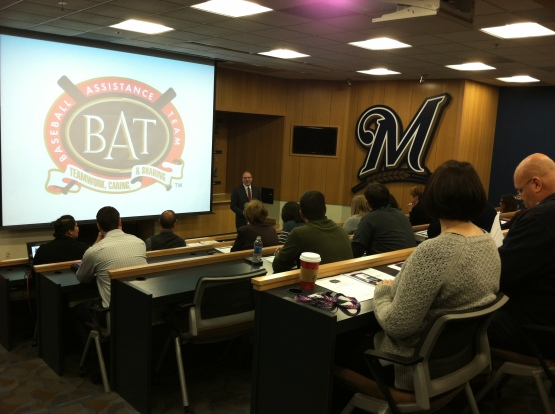 B.A.T. Advisor, Laurel Prieb visits with the employees of the Milwaukee Brewers